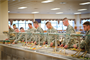 Pictured here is the Harmony Church trainee barracks complex Dining Facility, completed in February 2010. It spans 55,000 square feet with a serving capacity of 2,600 (per 90 minutes). The $8.6 million facility was constructed as part of a $73.2 million barracks and brigade headquarters complex, awarded to prime contractor B.L. Harbert of Birmingham, Ala.